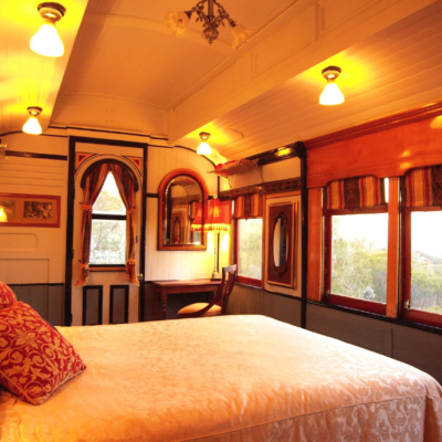 """Ruwenzori Retreat – Built in 1899 as a premiere passenger car for the main intercity routes, the """"Pullman"""" has been luxuriously remodelled to sleep up to six people."""